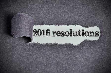 2016 resolutions  word under torn black sugar paper Archivio Fotografico