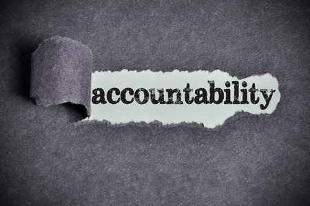 accountability  word under torn black sugar paper