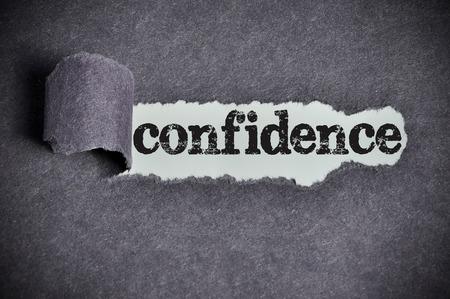 confidence  word under torn black sugar paper