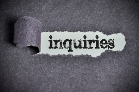 inquiries: inquiries  word under torn black sugar paper Stock Photo