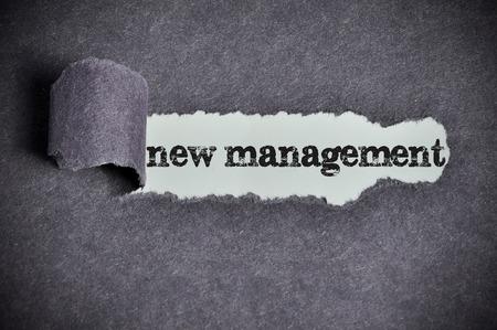 new management  word under torn black sugar paper