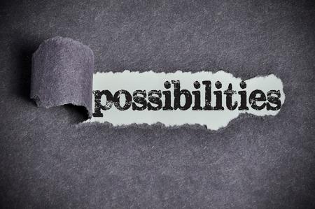 possibilities: possibilities  word under torn black sugar paper Stock Photo