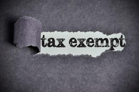 tax exempt  word under torn black sugar paper