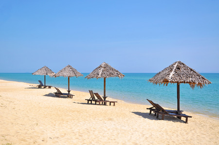 idling: The Beach chairs and umbrellas on a beautiful panoramic beach view and south china sea with copy space area