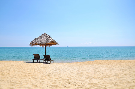 The Beach chairs and umbrella on a beautiful panoramic beach view and south china sea with copy space area