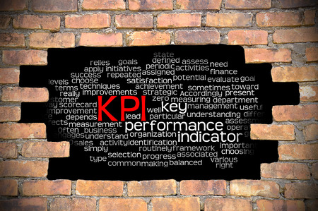 wall cloud: Business Concept - Hole in The Brick Wall Fill With Word Cloud Of Key Performance Indicator (KPI) And Its Related Words.
