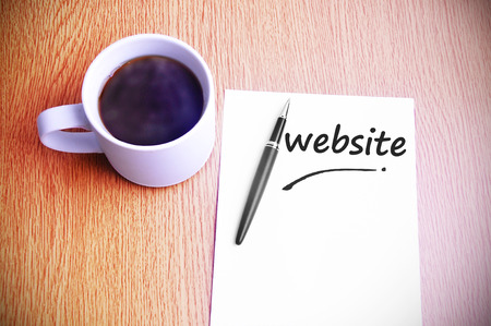 steamy: Business Concept  Steamy Coffee And Black Pen With White Paper Written Website.