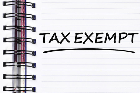 exempt: tax exempt words on spring note book.