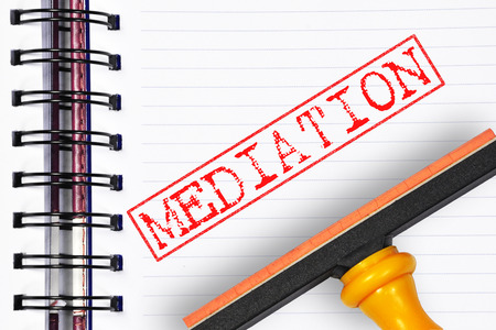 mediate: mediation rubber stamp on the note book.