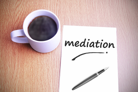 mediator: Coffee on the table with note writing mediation.
