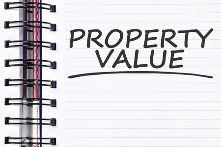 finer: property value words on spring note book. Stock Photo