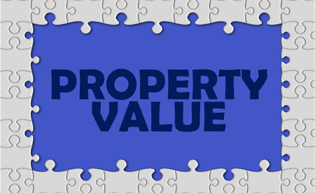 finer: property value with jigsaw border. Stock Photo