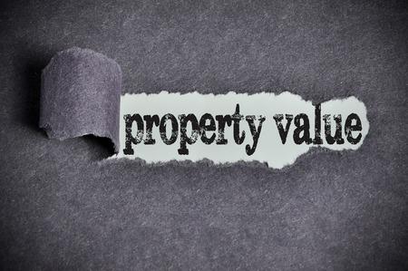 best location: property value word under torn black sugar paper.