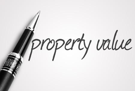 finer: pen writes property value on paper.