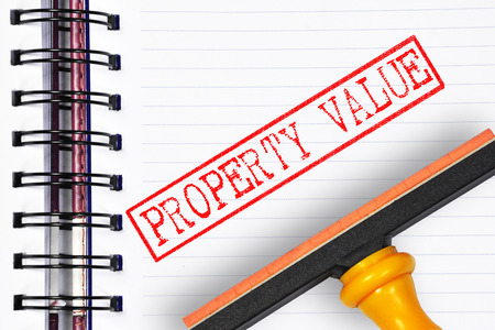 finer: property value rubber stamp on the note book.