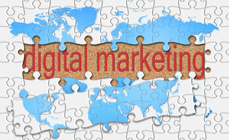reveal: jigsaw reveal digital marketing word on cork background. Stock Photo
