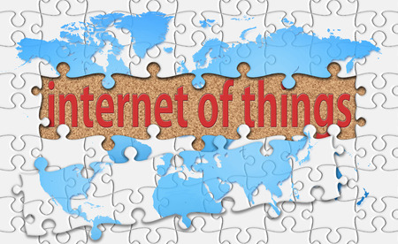 reveal: internet of things word with reveal jigsaw. Stock Photo