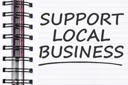 local business: support local business words on spring note book.