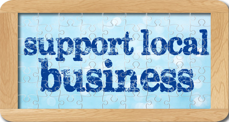 local business: jigsaw puzzle of support local business in wooden frame.