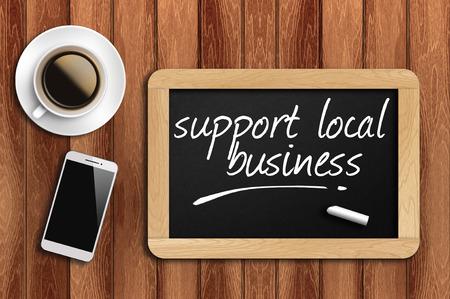 coffee telefoon en schoolbord met make steun lokale business woorden.
