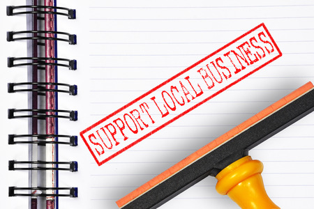local business: support local business rubber stamp on the note book.
