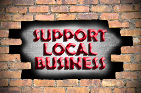 local business: support local business in the hole of brick wall.