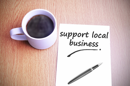 local business: Coffee on the table with note writing support local business.