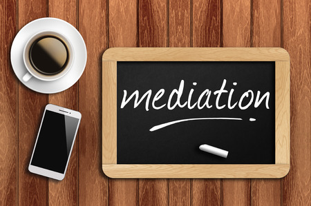 mediate: coffee phone and chalkboard with mediation words.