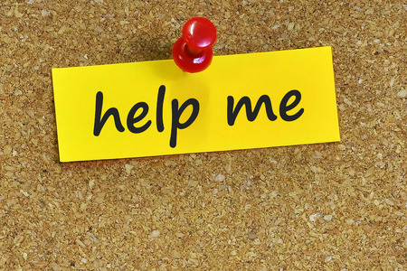help me: help me  word on notes paper with cork background. Stock Photo