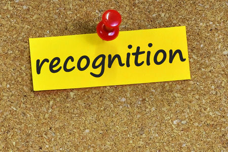recognition  word on notes paper with cork background.