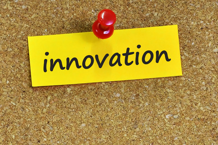 innovation word: Innovation  word on notes paper with cork background. Stock Photo