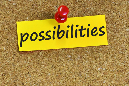 possibilities: possibilities  word on notes paper with cork background.
