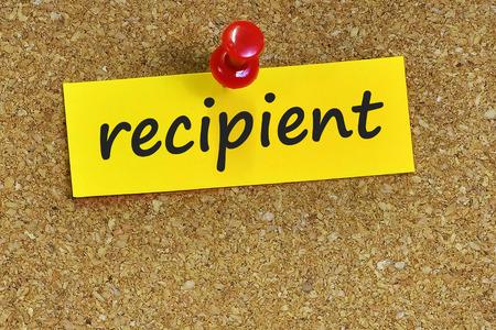 recipient: recipient  word on notes paper with cork background.