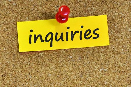 inquiries: inquiries  word on notes paper with cork background. Stock Photo