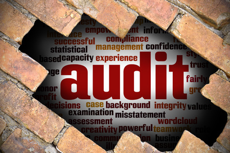 seeks: Hole at the brick wall with audit word cloud inside. Stock Photo