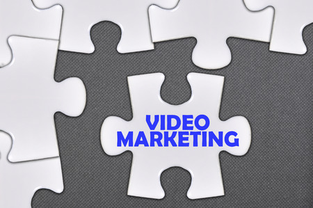 jigsaw puzzle written word video marketing. Archivio Fotografico
