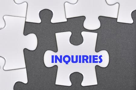 inquiries: The jigsaw puzzle written inquiries Stock Photo