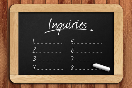 inquiries: Chalkboard on the wooden table written inquiries list.
