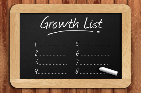 restaurant rating: Chalkboard on the wooden table written growth list. Stock Photo