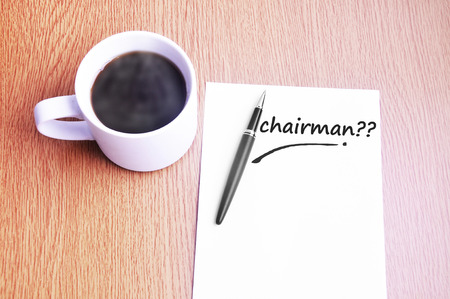 chairman: Coffee, pen and notes write chairman. Stock Photo