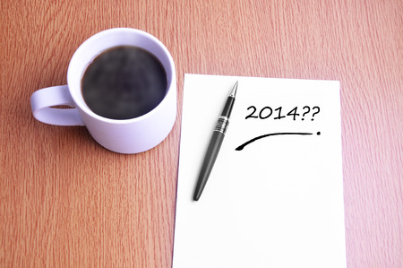 restaurant rating: Coffee, pen and notes write 2014. Stock Photo