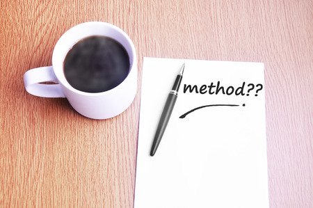 restaurant rating: Coffee, pen and notes write method.