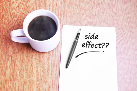 side effect: Coffee, pen and notes write side effect. Stock Photo