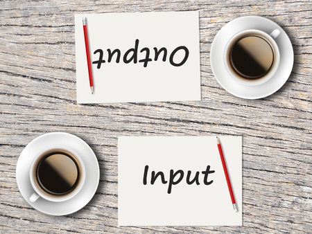 output: The Business Concept : Comparison between input and output   . Stock Photo