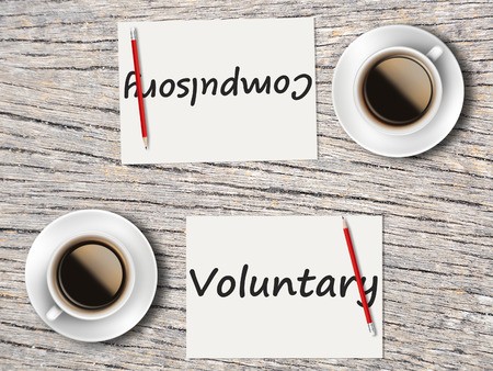 compulsory: The Business Concept : Comparison between compulsory and voluntary   . Stock Photo