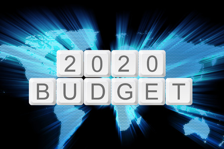 money matters: world glow background and keyboard button with word 2020 budget.