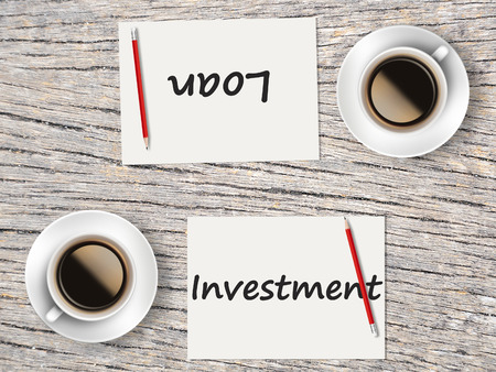 comparisons: The Business Concept : Comparison between investment and loan  . Stock Photo