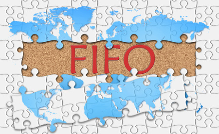 reveal: Jigsaw puzzle reveal  word fifo. Stock Photo