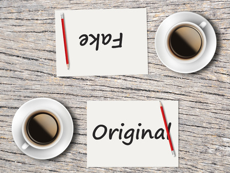 comparisons: The Business Concept : Comparison between original and fake    . Stock Photo