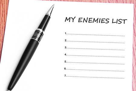 enemies: Pen  and notes paper with my enemies list.